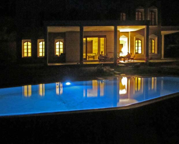 swimmingpool lit up at night
