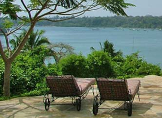 relax on sunlouger over looking pool adn Kilifi Creek